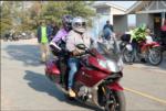 IMG: 2 people 1 motorcycle