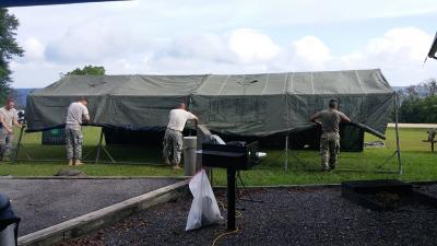 Arkansas National Guard members set up a tent for RMR